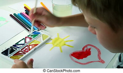 Little Boy Draws Paints - Little boy paints with wet paint...