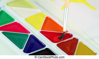 Little Boy Draws Paints - The little boy smears the paint...
