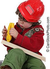 Little boy dressed an manual worker