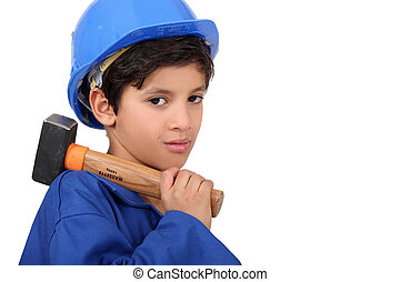 little boy dressed as a craftsman holding a hammer
