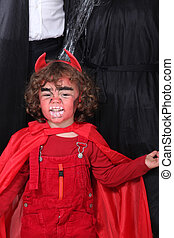 little boy dressed as a devil
