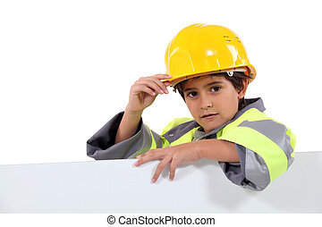 Little boy dressed as construction worker