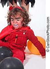 Little boy dressed as devil