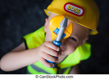 Little boy dressed as foreman builder