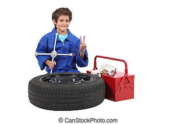 Little boy dressed as mechanic