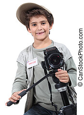 Little boy dressed as reporter