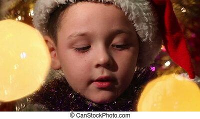 little boy dressed as Santa Claus 2