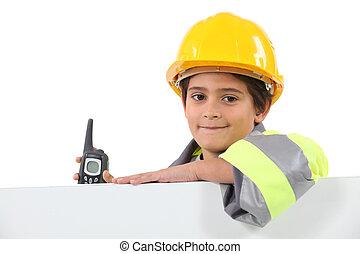 little boy dressed in roadman