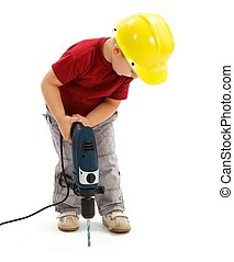 Little boy drilling in ground, wearing protective helmet