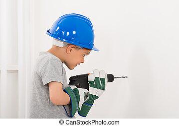 Little Boy Drilling Wall