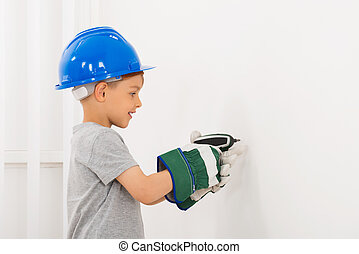 Little Boy Drilling Wall