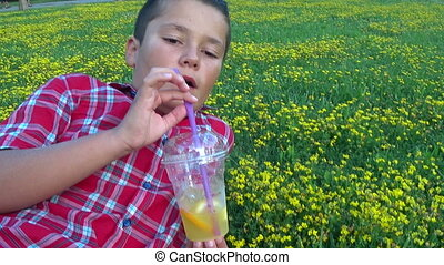 little boy drinking lemoonate at the outdoor