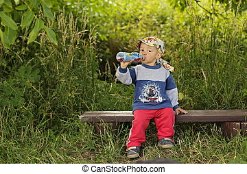 Little boy drinking