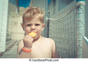 Little boy eating an ice-cream - eating snacks and ice cream...