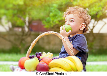 Little boy eating apple