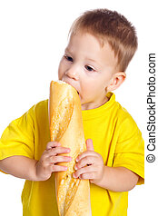 Little boy eating french baguette - Little boy eating the ...
