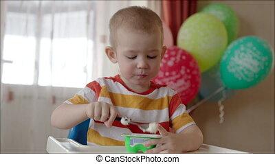 Little Boy Eating Yogurt from the Jar