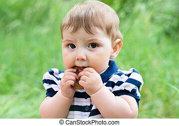little boy eats a bagel