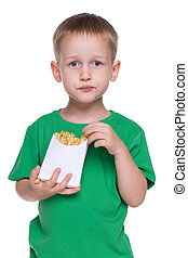 Little boy eats fries
