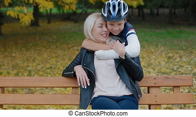 Little boy embrace his mother - Young caucasian woman...