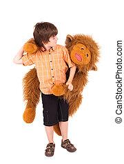 Little boy embraces a teddy bear