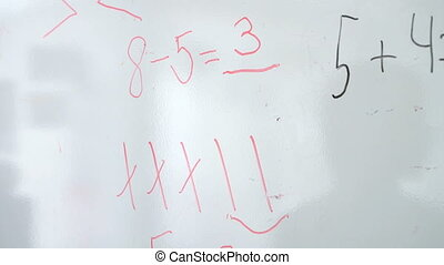 Little boy erases equation mathematics from board - Little...