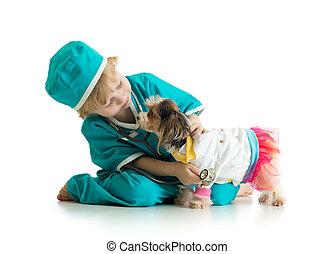 little boy examining puppy dog, isolated on white background