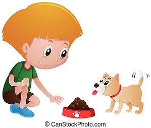 Little boy feeding pet dog
