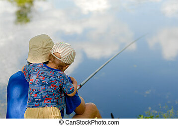 Little boy fishing with father in blue sky reflection -...
