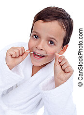 Little boy flossing teeth - closeup, isolated