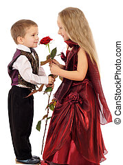 Little boy gives a girl a rose, isolated on white