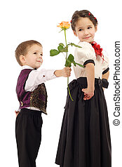 Little boy gives a girl a yellow rose, isolated on white