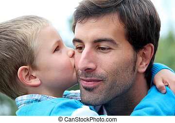 Little boy giving daddy a kiss