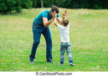 Boy Giving High Five To His Father