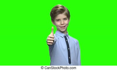 Little boy giving thumb up. Green hromakey background for...