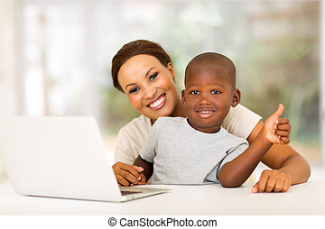 little boy giving thumb up - little boy sitting with his...