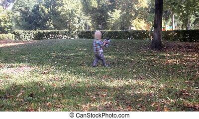 little boy go across park