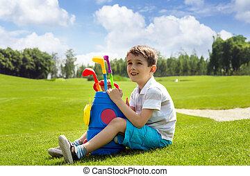 Little boy golfer
