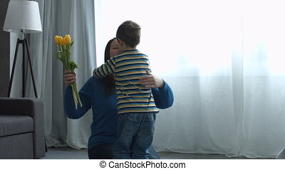 Little boy greeting his mother on Mother's day