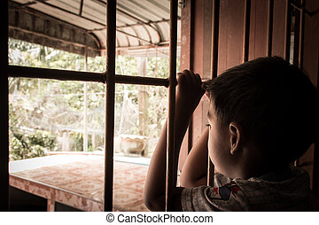 little boy Hand in jail looking out the window