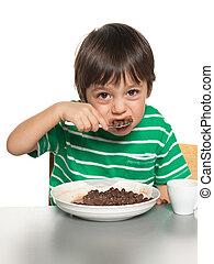 Little boy has his breakfast