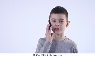 Little Boy Having a Phone Call Isolated on White Background