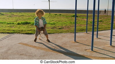 Little boy having fun at playground - Front view of mixed ...