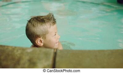 Little boy having fun in the pool