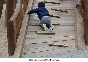 Little boy having fun on a playground
