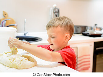 Little boy helping with the baking