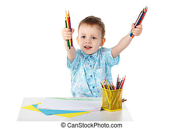 Little boy holding a lot of colored pencils isolated on white background