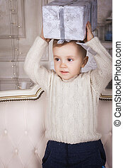 little boy holding a present box