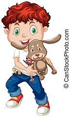 Little boy holding a puppy