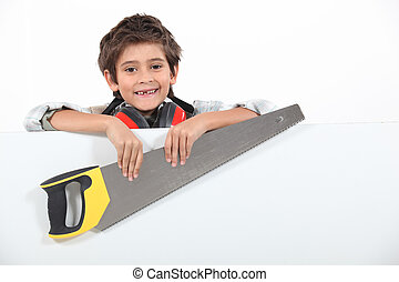 Little boy holding a saw on white background